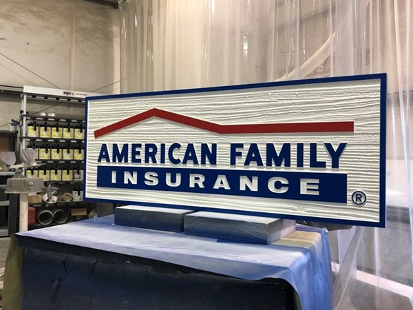 Red, White, and Blue Insurance Sign
