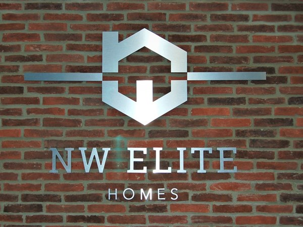 Silver New Elite Homes Sign with Logo