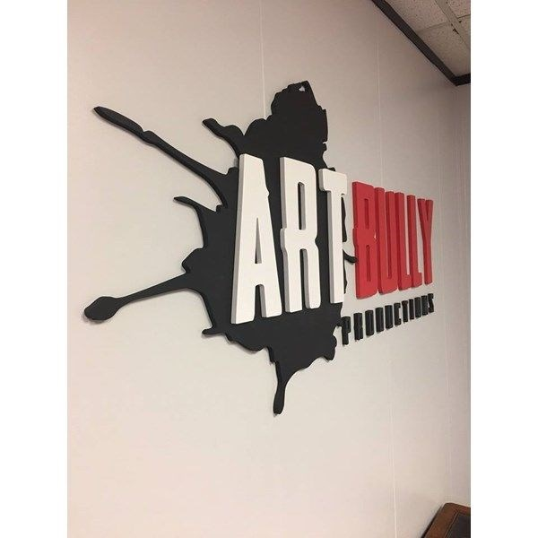 Black, Red, and White Paint Splatter 3D Logo on Wall