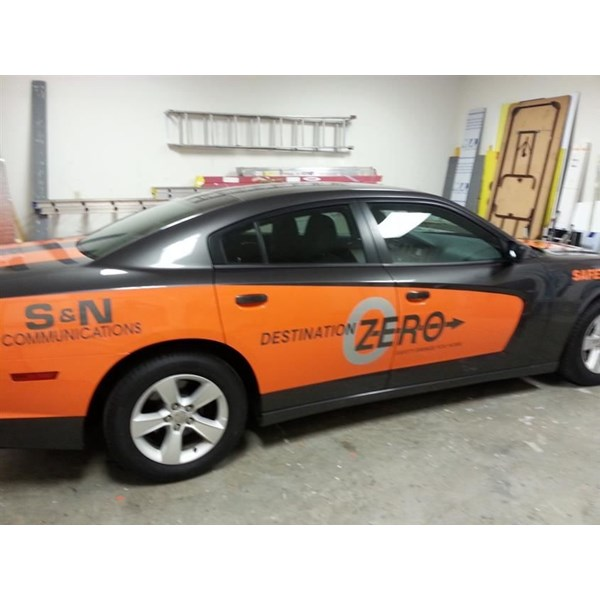 Orange color change vinyl and cut vinyl graphics make this Charger a big hit with their employees.  I think that the orange makes the car go FASTER!