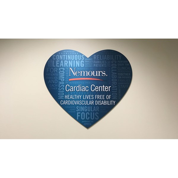 Brushed metal aluminum composite custom shaped and printed with the clients custom design.