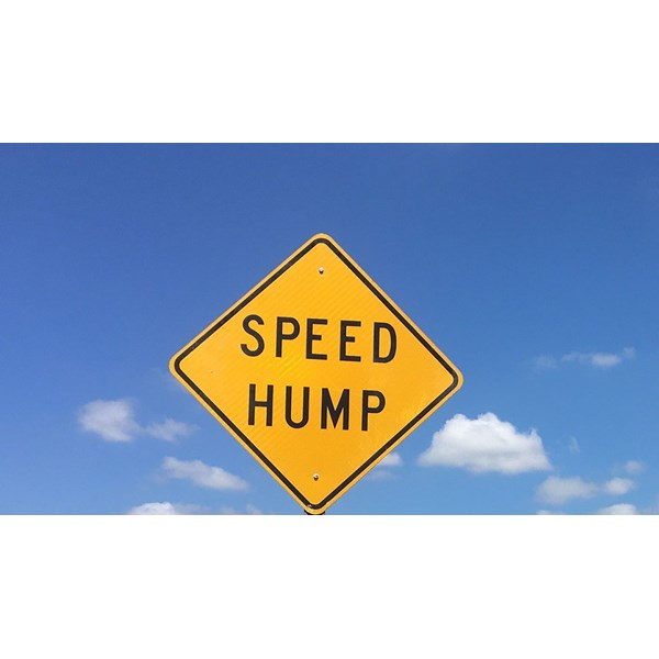Prologis was looking to update their worn speed hump signs.