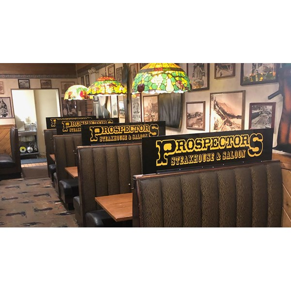 Booth screens for Prospectors help their patrons enjoy a safe and healthy dining experience by preventing the spread of germs.