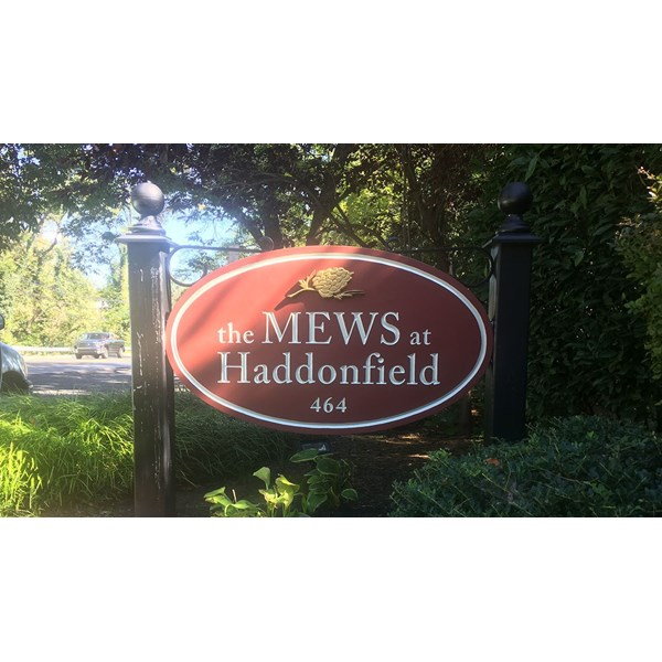 The Mews at Haddonfield wanted to make the lettering on their sign easier to read. We diligently re-painted the lettering from dark gold to a light tan color.
