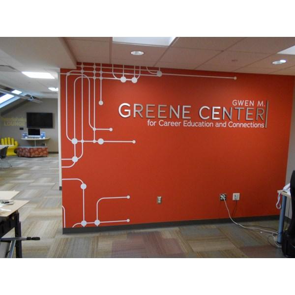 Dimensional letters with a wall graphic create a layered look!