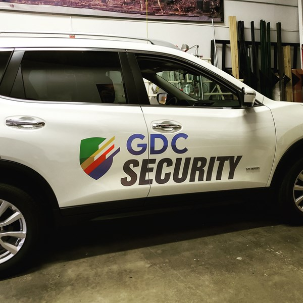 Google needed some branding for their security vehicles. Some vinyl decals and lettering with their logo.