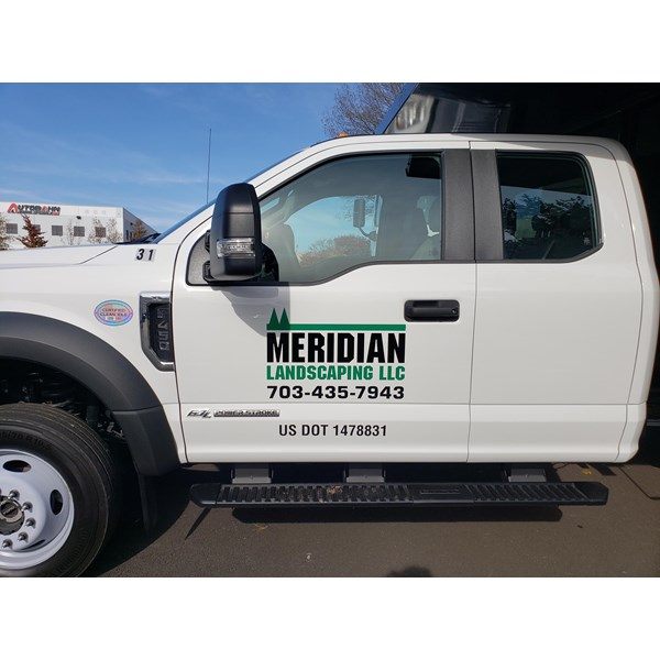 Another truck for Meridian Landscapings fleet needed some logo installation.