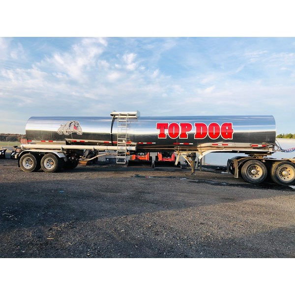 Top Dog needed some branding on their tanker truck. We installed their name and logo to the sides and rear.