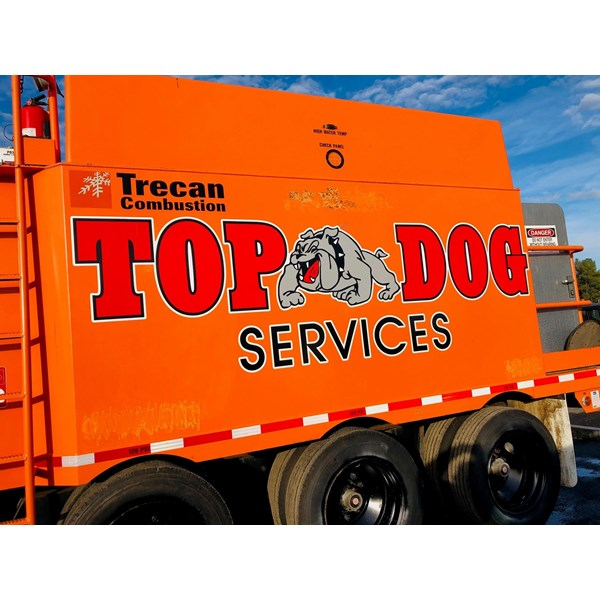 Top Dog got some new machinery and needed more branding. This logo pops on that orange!