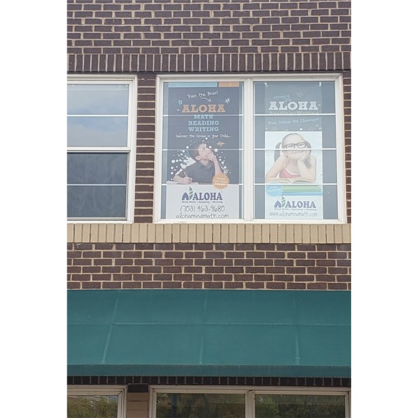 This perforated vinyl for Aloha Mind was installed on the exterior of the second floor window.