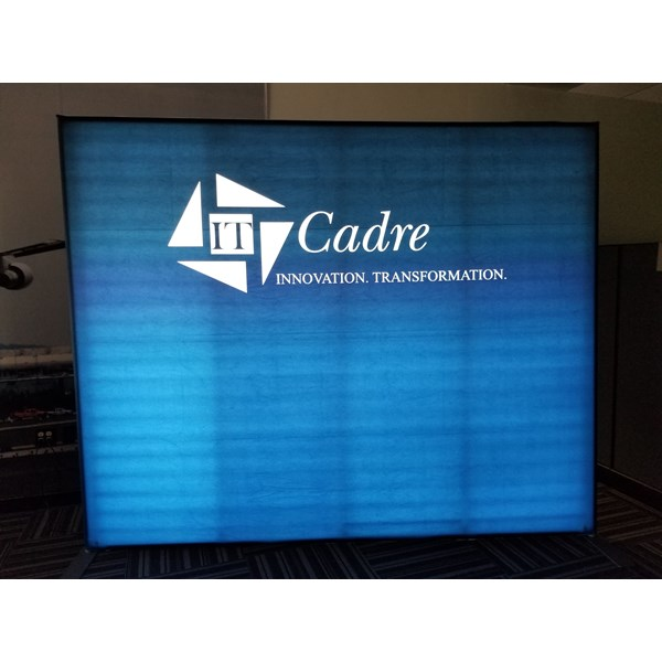 Illuminated custom fabric display is 10 tall. This lit backdrop will attract at your next show!