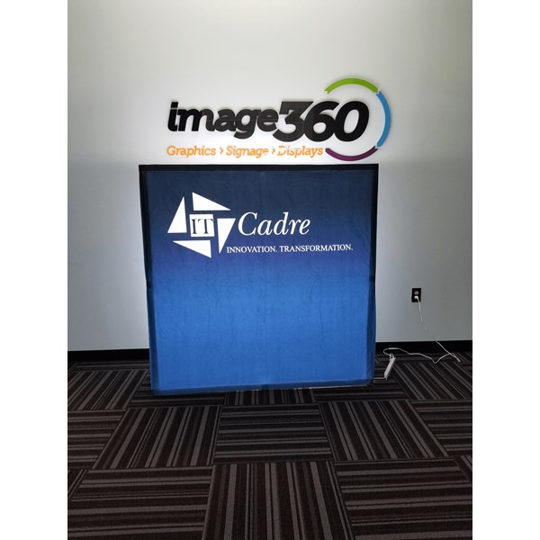 Illuminated custom printed fabric display is 5 tall. Easy to assemble, and light weight for easy travel for shows!