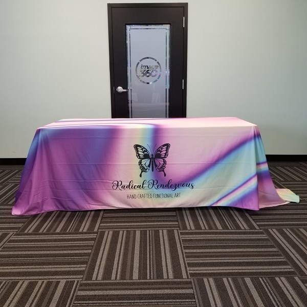 This beautifully printed table cover is 8ft long. Our fabrics are printed with sublimated inks, which are washer friendly!